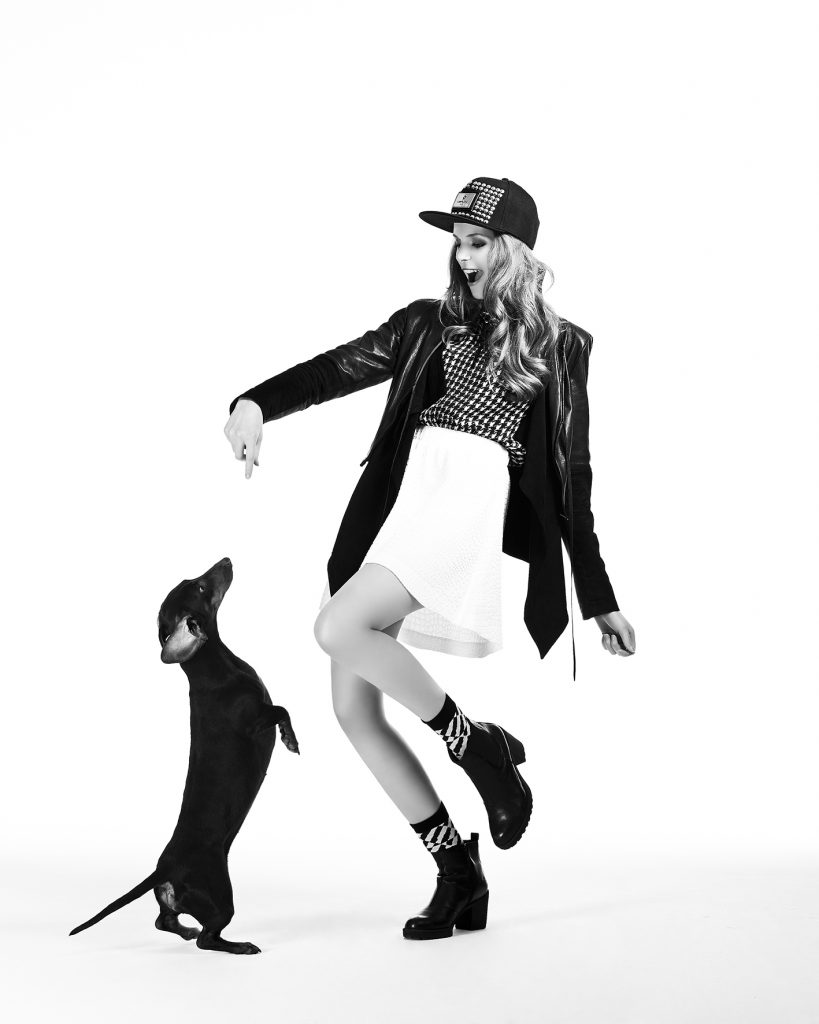 Female black and white fashion editorial by Heidi Rondak with sausage dog for Ajouré Germany showing model Theresa Schreck
